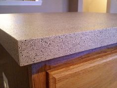 DIY countertop treatment - GRANITE LOOK - this is great! I've been thinking of doing this, and this entry gives a good overview of pros and cons and how to. from The Brewers in Progress pb†