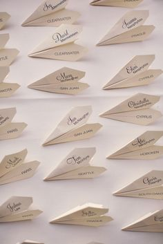 Travel theme escort cards - paper planes (by Allison Miracco, Photo by Ryan + Heidi)>>>>TELL YOUR FRIENDS that we'd love to see them at our aviation themed restaurant, The Left Seat West, in Glendale, Arizona!! Check out our décor at: http://www.facebook.com/pages/Left-Seat-West-Restaurant/192309664138462