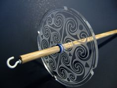 This 1.9 ounce drop spindle is great medium weight for DK/sport weight yarns. Made of cut acrylic and oak, its as much fun to watch the spindle as it