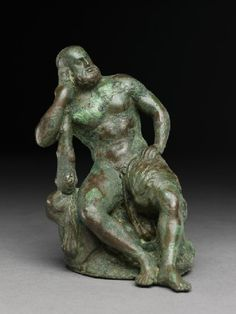 Figure of the hero god Heracles with his club seated on a lion  south Bactria, 1st century BC - 1st century AD (100 BC - AD 100)