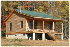 Huntsman Cabin Plans - This pretty little front porch cabin is just one of dozens of cabin, cottage, barn, garage and outbuilding plans that you'll find at BackroadHomes.com