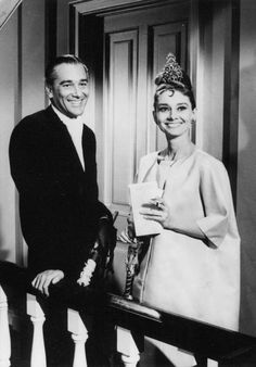 The actress Audrey Hepburn (as Holly Golightly) photographed with the actor…
