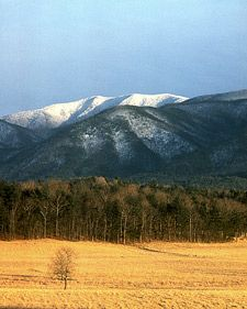 Snowy mountain peaks rise above the valley in Cades Cove.