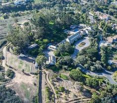 7007 Country Club Dr, La Jolla, CA 92037 is For Sale - Zillow | 17,368 sf | 7 bed 14 bath | 8.25 acres | built 1959 | 25,000,000 USD ||| vast acreage and once-in-a-lifetime opportunity. Gorgeous panoramic ocean and village hillside views are enjoyed from softly sloped areas throughout the vast property of orchards terraced gardens expansive lawns and meandering walkways. Exquisitely manicured grounds surround the classic manse including large circular motor court pool and patio.