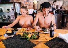 Exhibitionists flock to The Black Cat eatery in Berlin where staff serve nude | Daily Mail Online