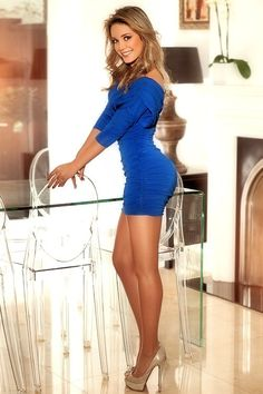 This is a great look...great legs in a tiny little blue dress and platform high heels.