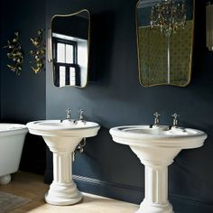 Dual white vanity pedestal basins. They really stand out against the dark grey wall and matching mirrors. #vanities #basins #mirrors