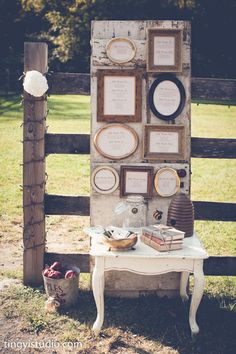 A seating chart in old mismatched frames then placed on an old barn door. Adding more decorations around the door gave it just the perfect look Photography By dp Studio Ting Yi Phtoto & Cinema...