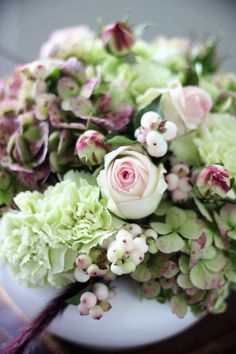 snowberries, carnations, hydrangea, garden roses with ornamental grass