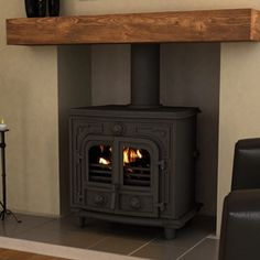 The Broseley Hercules Multifuel / Wood Burning Boiler Stove is designed to be powerful, robust and capable of performing the most demanding tasks. With an output to water of up to and up to to the room, the Broseley Hercules woodburner Electric Wood Burning Stove, Small Wood Burning Stove, Stove Fireplace, Fireplace Design, Fireplace Ideas, Boiler Stoves, Home Heating Systems, Stoves For Sale, Multi Fuel Stove