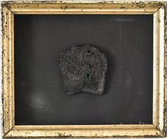 Victory. 2005  Framed piece, burnt toast, graphite/crayon on black paper