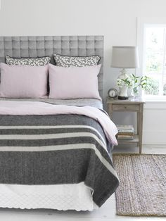 I am just in love with the idea of grey for my bedroom - clean and relaxing. i like the touch of pink too