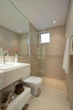 O banheiro amplo aposta em tons de cinza. O projeto é da arquiteta Brunete Fraccaroli Foto: Demian Golovaty / Divulgação