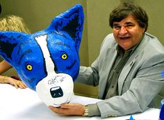 A papier mache Blue Dog head created by Sophie Borchert and her mother, Laura, for the St. Margaret Mary Catholic School Krewe of Heads parade when Sophie was a third-grader at the school, 12 years ago, was on display and autographed by George Rodrigue during the opening reception of his exhibit at the Slidell Cultural Center in Olde Towne Slidell. All of the Borcherts, including Slidell Councilman Bill Borchert, were thrilled at Rodrigue's delighted response to the work of art his Blue Dog…