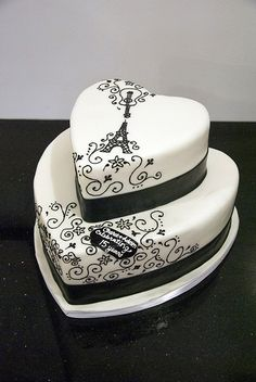 White Heart Cake with Black Drawing of Guitar, Eiffel Tower and Swirls