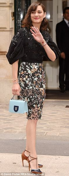 Screen beauty: French actress Marion Cotillard looked stunning in a floral dress with a st...