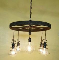 Antique steel wheel chandelier, with bed spring shades