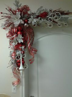 corona de navidad reds and frosty Whites assembled together to create a elegant corner door swag, by rose/designer details Christmas Swags, Xmas Wreaths, Christmas Mantels, Elegant Christmas, Noel Christmas, Simple Christmas, Christmas Ornaments, Christmas Centerpieces, Xmas Decorations