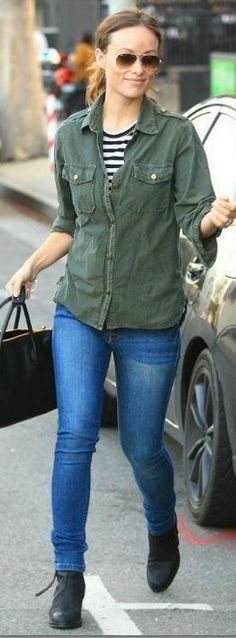 Who made Olivia Wilde's green button down shirt, black handbag, brown sunglasses, and ankle boots? Shoes – Acne  Purse – Miu Miu  Sunglasses – Ray-Ban  Shirt – Current/Elliott