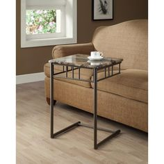 This gorgeous snack table is beautifully crafted to be both attractive and convenient. While you enjoy the comfort of your own couch, the marble top can be pulled up right to your chest. The lovely medal frame is designed to fit under your couch.