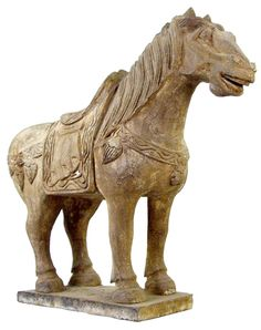 Ancient Asian. Carved black basalt horse stands on a base, the head in an alert attitude, draped saddle and blanket, the mane to one side. Mint condition. 400 AD