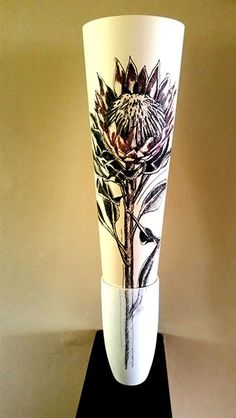 Hermien Van Der Merwe;  Title: Protea drawing in Vase:  Nes jy is (Just as you are) Medium: Mixed media drawing on paper (pen-and-ink, graphite, watercolour) in ceramic vase Size: Drawing:  595 x 420mm; Vase:  180mm (height)