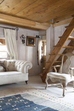 Swiss chalet | French Country Living Antiques like the pine with the lovely soft white furniture, but would not use the rug they did
