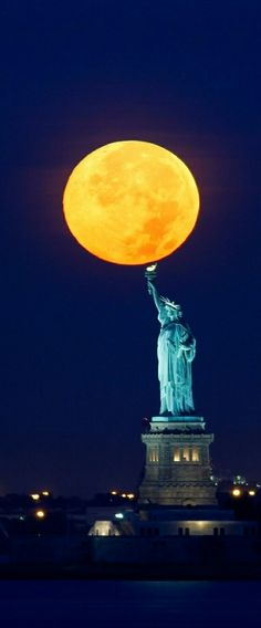"""The moon sets behind the Statue of Liberty in New York A supermoon is the coincidence of a full moon or a New moon with the closest approach the Moon makes to the Earth on its elliptical orbit, resulting in the largest apparent size of the lunar disk as seen from Earth.The technical name is the perigee-syzygy of the Earth–Moon–Sun system.The term """"supermoon"""" is not astronomical, but originated in modern astrology"""