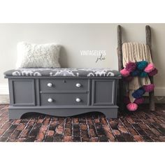 Vintage Lane cedar chest refinished using General Finishes Driftwood milkpaint.  Seat reupholstered using designer fabric in gray tones.