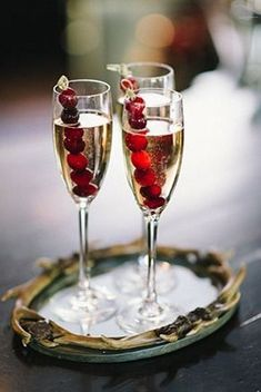 Frozen cranberry skewers to keep champagne cold. So festive for fall and winter parties!