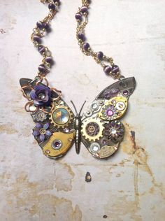Steampunk Butterfly Necklace - Custom Design Silver Butterfly with Watch Gears Brass Flowers and Jewels. $108.00, via Etsy.