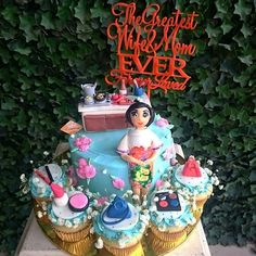 """A Customized Birthday Cake and Cupcakes for the """"Greatest Wife and Mom!"""" Yes it contains all her favorite things, she loves to cook, she loves make up, beautiful dresses, Bags and Flowers! Its a layers of Banana Chocolate Cake surrounded by Strawberry Cupcakes!  Contact us for more information via Whatsapp 0878.77.888.586    #cassonadecake #dessert #Customized #birthday #mother #cake #doll #makeup #makeup #bags #cooking #kitchen #cakeonlinejkt #cakejkt #homemade #jktfoodbang"""