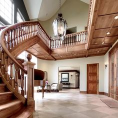 The staircase commands attention in the foyer of this San Juan Island residence.  MLS 818297