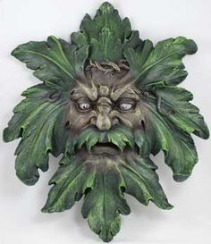In man-sized proportions, the Greenman is displayed with wild eyes and wise features, with green leaves sprouting to form his hair, beard and mustache. Description from bonanza.com. I searched for this on bing.com/images