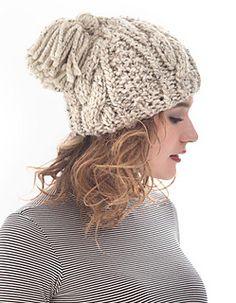 Lion Brand Yarn Online Patterns > Cabled Tassel Hat- free knitting pattern