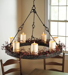 Metal hanging candle chandelier and LED pillar candles  ****