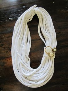 A Surcee Life: A T-shirt Necklace tutorial.  This site is great.  Step-by-step instructions with pictures.  So easy.  I am so doing this.