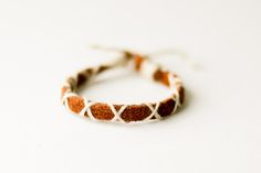 Boys' / men's leather and yarn DIY bracelet (or necklace!). Use leather or suede scraps, or buy new laces.