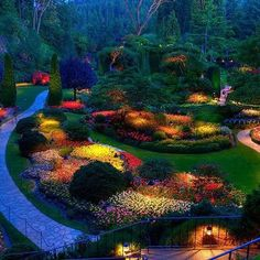 Butchart Gardens at night-Canada  One of the most famous gardens in the  world which is counted among the best of the best. Located in British Columbia   and is placed near Victoria on Vancouver  Island. There's never a dull season at Butchart Gardens!