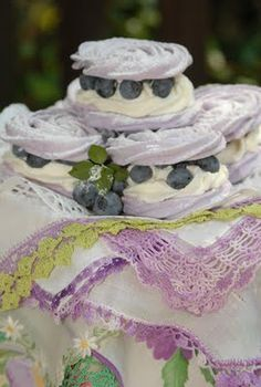 Beautiful tea party treats: Blueberry Meringues. That also links to 'Chocolate Dipped-Strawberry Meringue Roses'