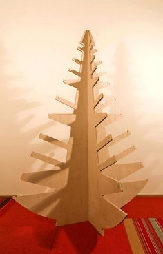 http://uuldesign.com/wp-content/uploads/2010/12/re-useable-plywod-christmas-tree-alternative.jpg