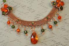 Wire Wrapped Necklace w/ Orange Lucite & Swarovski Crystal. $60.00, via Etsy.