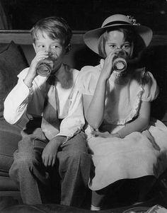A young Peter Fonda and Jane Fonda drinking milk 1949 | Rare and beautiful celebrity photos