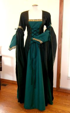Love the sleeved on this- This awesome dress is perfect for a stroll over the medieval market or ren faire, it would also be perfect as a wedding dress. It is made out