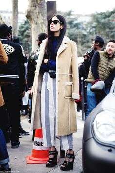 Paris Fashion Week street style dominating the shearling jacket and stripes