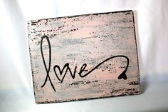 Pink love Wall Hanging Art, distressed pink on black, hand painted, salvaged wood, 9.25 x 11.5 inches. $12.00, via Etsy.