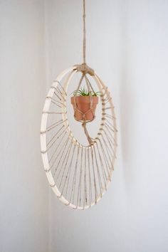 Need a little sunshine in your life? This plant hanger will definitely brighten up your room. I used two bamboo hoops and wrapped twine across them to give it a sun ray feel to it. I then hung a mini plant hanger at the top and with a mini pot inside. Diy Tassel Garland, Garland Hanger, Macrame Projects, Craft Projects, Craft Tutorials, Diy Home Crafts, Arts And Crafts, Plant Crafts, Adult Crafts