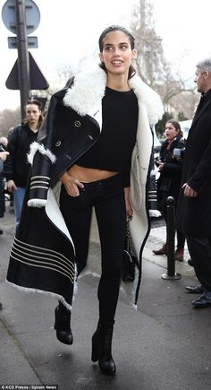 Monochrome magic: Rising model Sara Sampaio teamed a black top with skinny jeans and heeled boots