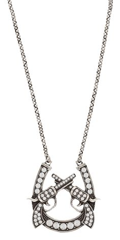 Rock 47® by Wrangler® Outlaw Rider Triple Crossed Pistols Horseshoe Necklace. This silver-tone 18 inch matinee length necklace features a rhinestone lined horseshoe set with a pair of six-shooter pistols crossed at the barrel.