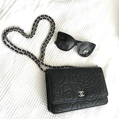 Chanel Camelia WOC  Chanel Wallet on Chain in black with Camelia pattern. Combined with Chanel Sunglasses in black.  This combo is perfect for the weekends to run some errands.